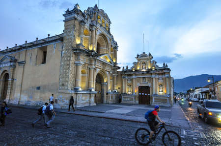 A small Cathedral illuminates in Guatemala's Antigua when night falls. Only days before the eruption of Stock Photo