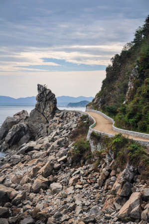 Lonely coastal road leads along the Japanese sea and beach in the north of North Korea