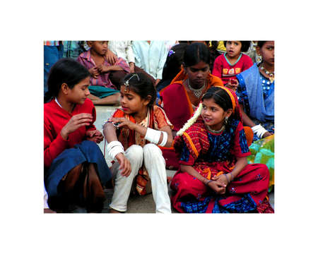 gujarat: Ahmadabad, Gujarat India - January 3, 2006. small group of Indian children in the village school Watch your older colleagues. Performances by students and teachers from Ahmedabad in Gujarat, India. January 3, 2006.