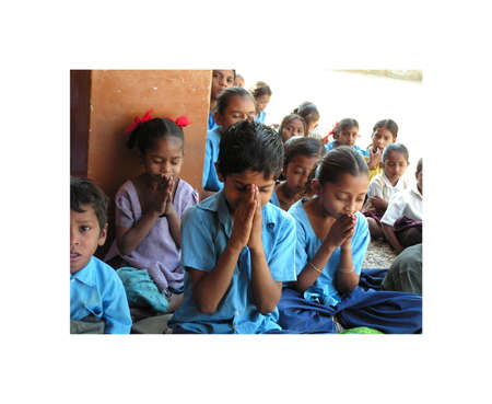 Ahmedabad, India - 12 December, 2005. A small group of Indian children in the village school is praying before class. Prayer of recollection and silence of children from Ahmedabad in Gujarat, India. December 12, 2005 Stock Photo - 13537763