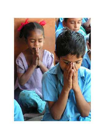 hindus:  Ahmedabad, India - 12 December, 2005. A small group of Indian children in the village school is praying before class. Prayer of recollection and silence of children from Ahmedabad in Gujarat, India. December 12, 2005