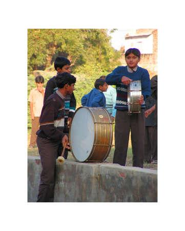 calisthenics: Ahmedabad, Gujarat, India - 26 November 2005 year.   School student in Ahmedabad. calisthenics, and relaxation, yoga. Gymnastic exercises to the sound of the drum.