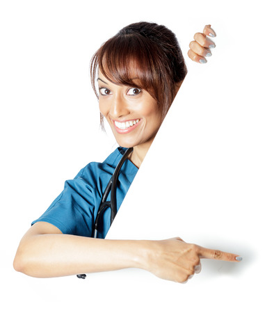 Attractive Indian doctor woman posing in a studio in front of a background Stock Photo - 22288848