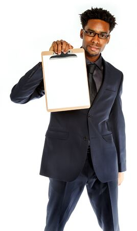 Attractive afro-american business man posing in studio isolated on a white background photo