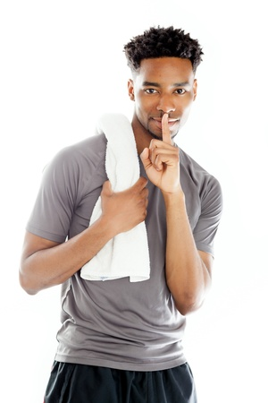 Attractive afro-american man posing in a  studio isolated on a background photo