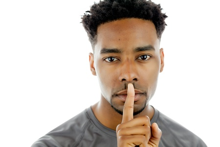 Attractive afro-american man posing in a  studio isolated on a background Stock Photo - 22289728