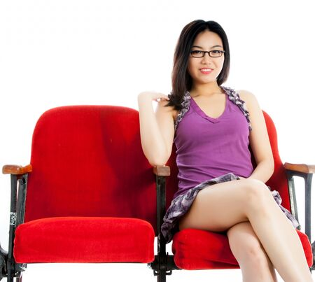 Attractive Asian girl in her 20s at the theatre isolate on a white background photo