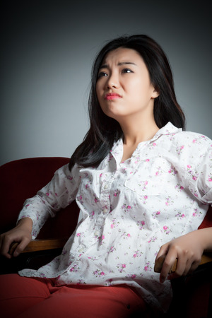 Attractive Asian girl in her 20s at the theatre isolate on a white background
