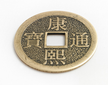 lucky chineese coin isolated on a white background