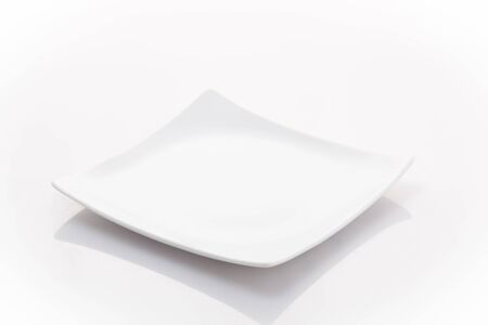 plate: one empty square plate isolated on a white background Stock Photo