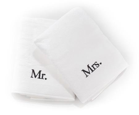 SE�ORA: El Sr. y la Sra. toallas blancas aislados en un fondo blanco Foto de archivo