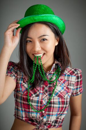 Sexy attractive asian girl country cowgirl outfit posing in studio photo