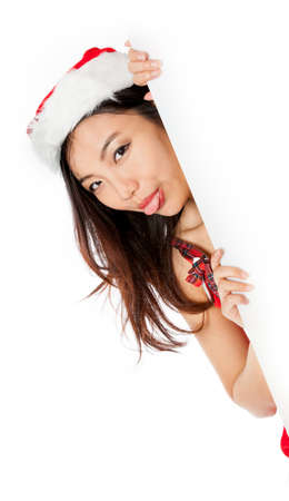 Attractive sexy santa claus asian girl in her 20s isolated on a white background photo
