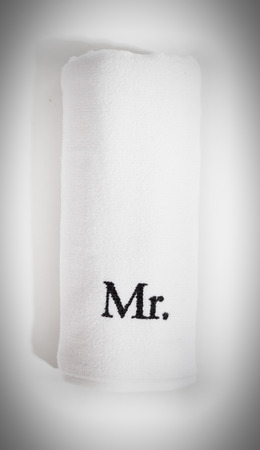 mr: rolled mr white towel isolated on a white background