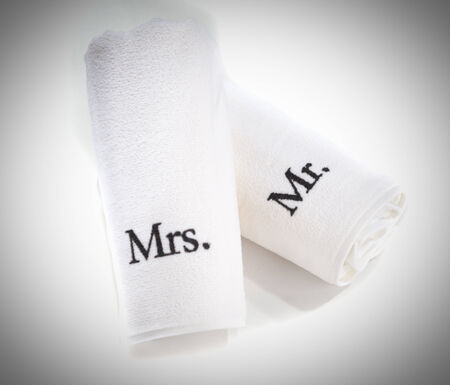 mr and mrs: mr and mrs rolled white towels isolated on a white background