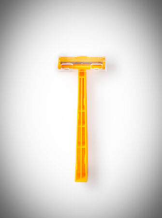 orange disposable razor isolated on a white background