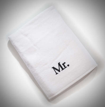 mr: mr white towel isolated on a white background