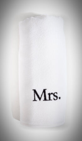 mrs: mrs rolled white towel isolated on a white background