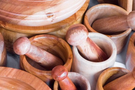 things that go together: Wooden mortars and pestles for sale at a market stall, Mexico City, Mexico Stock Photo