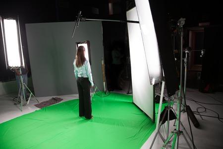 Female fashion model standing in a film studio Stockfoto