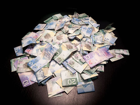canadian cash: Heap of Canadian dollar bills