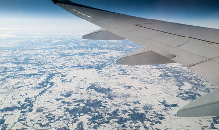 Aerial view of snow covered landscape viewed from airplane, Mexico City, Mexico photo