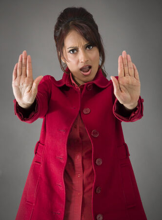 stop gesture: Indian young woman making stop gesture sign from both hands