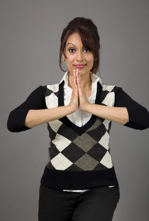 Indian businesswoman welcoming with hands joined photo
