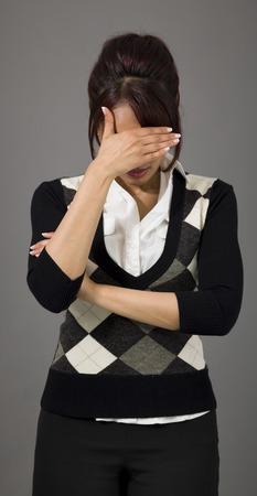 Indian businesswoman hiding her face