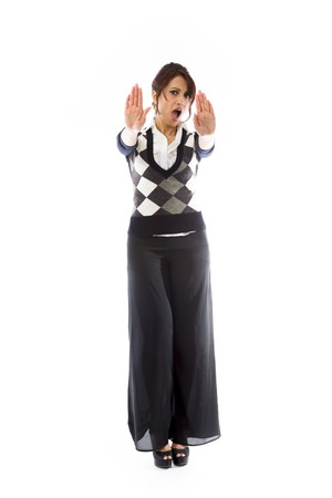 stop gesture: Indian young woman making stop gesture and showing stop