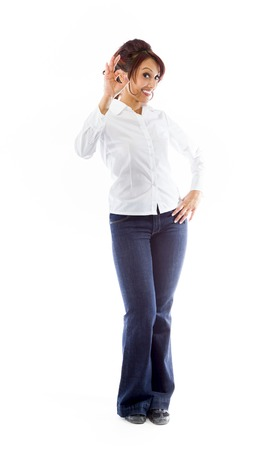Indian young woman showing ok sign isolated on white background photo