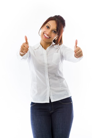 Indian young woman showing thumbs up from both hands isolated on white background photo
