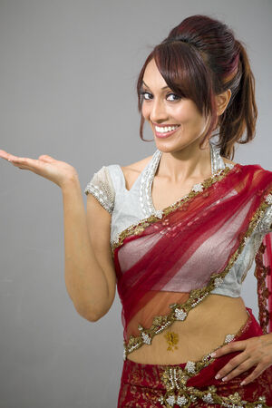 Young Indian woman showing product with open hand palm photo
