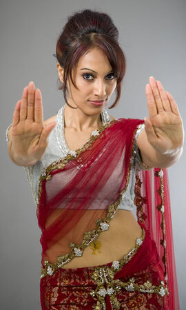 stop gesture: Young Indian woman making stop gesture sign from both hands