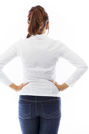 arms akimbo: Rear view of an Indian young woman standing with hands on hip Stock Photo