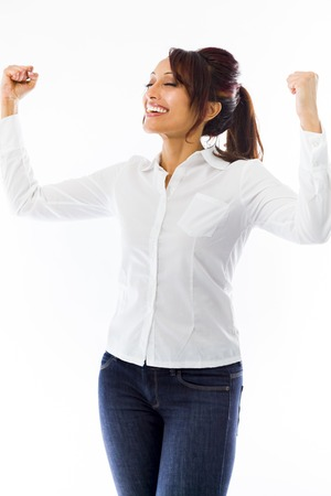 Indian young woman celebrating success with arms in air photo