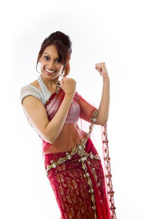 Young Indian woman celebrating success
