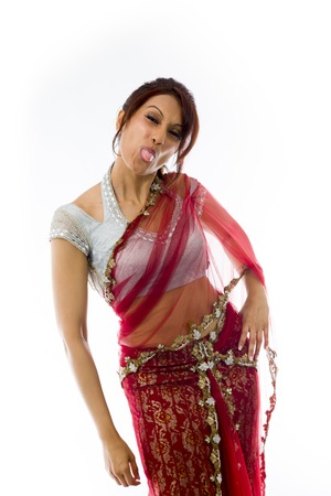 Young Indian woman sticking out her tongue Stock Photo