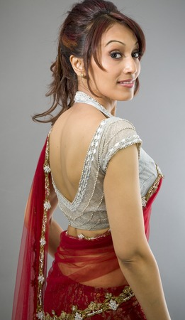 Side profile of an Indian young woman smiling