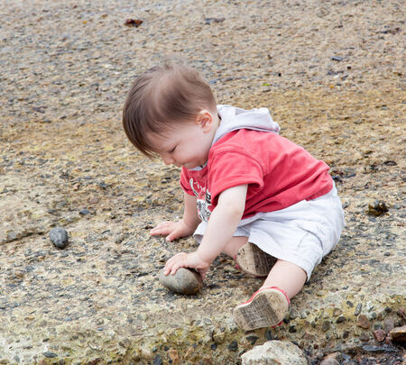 rock formation: Boy playing with rocks on the coast