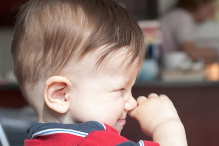 rubbing noses: Close-up of a boy rubbing his nose Stock Photo