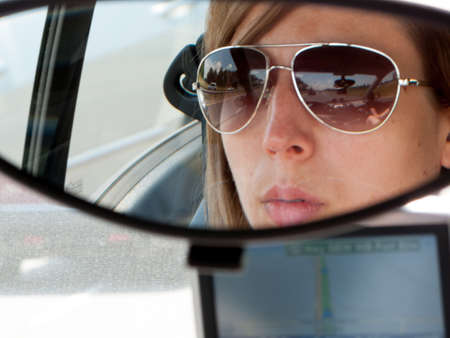 reflection: Reflection of a woman in the mirror of a car Stock Photo