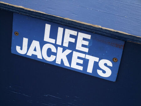 signboard: Close-up of a signboard of LIFE JACKETS Stock Photo