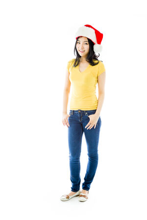 celebratory event: Asian young woman wearing Santa hat and smiling Stock Photo