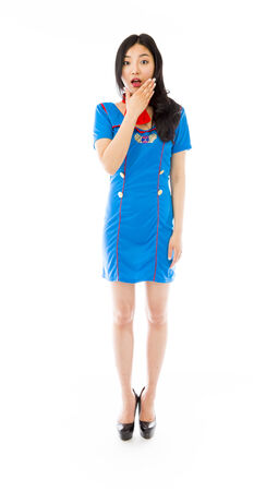Shocked Asian air stewardess with hand over mouth isolated on white background photo