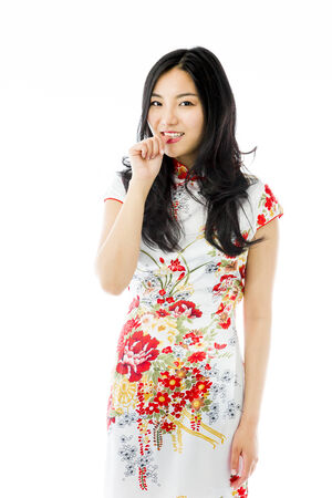 Asian young woman with finger in mouth photo