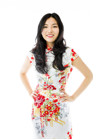 arms akimbo: Confident Asian young woman standing with arms akimbo