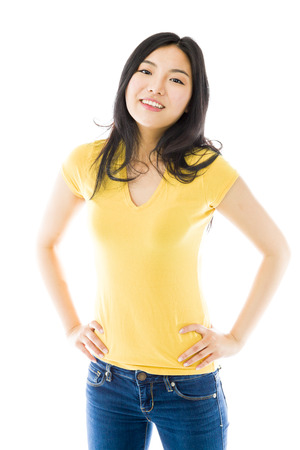 arms akimbo: Young Asian woman standing with her arms akimbo