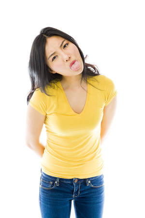 disrespect: Young Asian woman sticking out her tongue