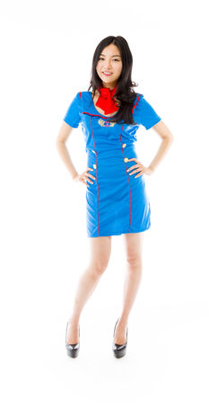 arms akimbo: Confident Asian air stewardess standing with arms akimbo